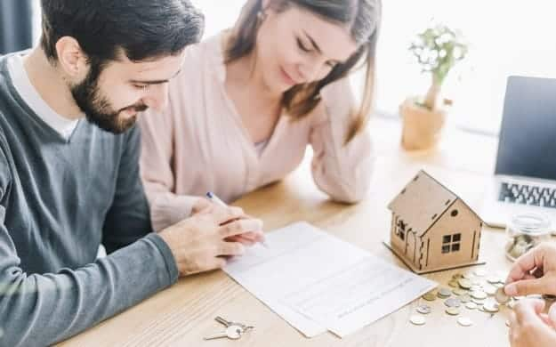 couple signing agreement Estate Planning
