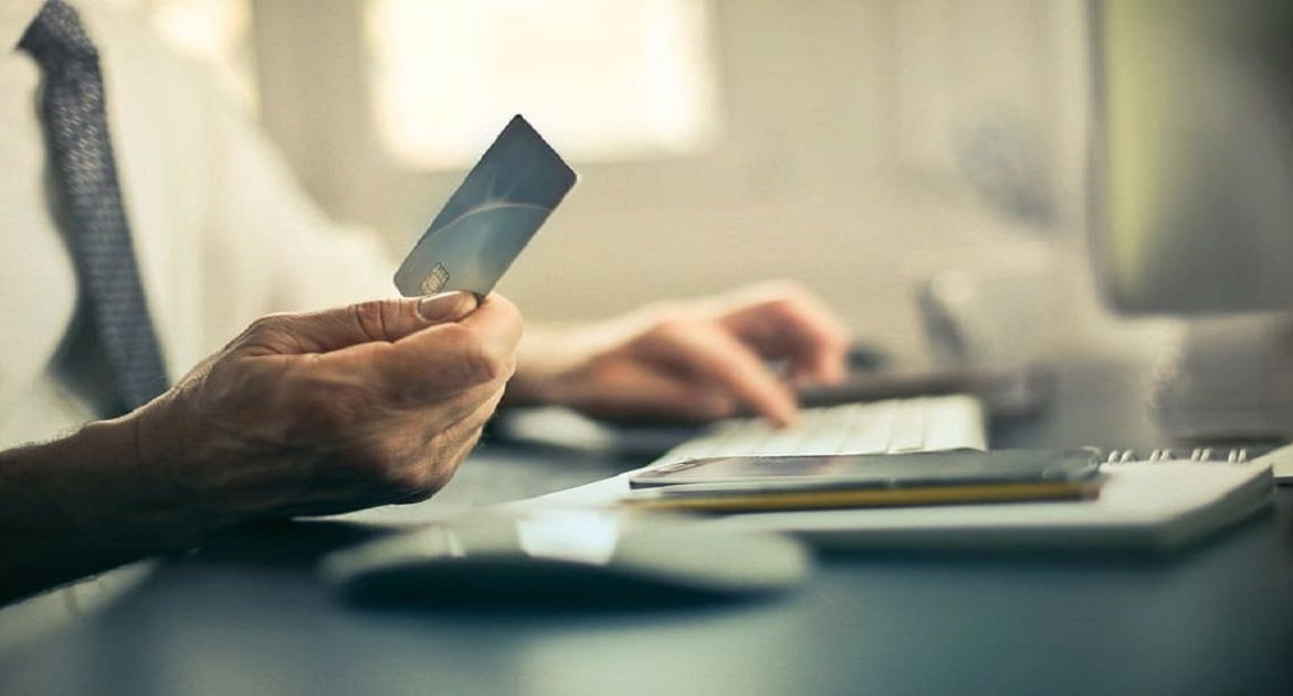 a person is using a credit card to pay for his bill | Pay Your Rent When You Can't Afford It